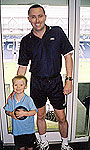 Jim and son, Kieran, relaxing at the home of Leicester City Football Club