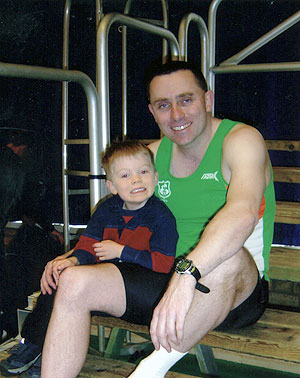 Jim having down-time with son Kieran after setting an Irish National record in the 60 metre hurdles at the European Championships in Sweden (2005)